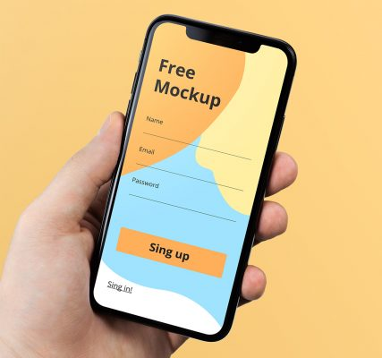 iPhone X in Free Hand Mockup
